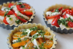tomato and mozzarella tarts with herbs